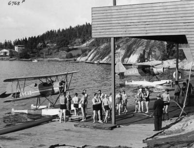 Seaplane and bathers at Ingierstand near Oslo, 1937