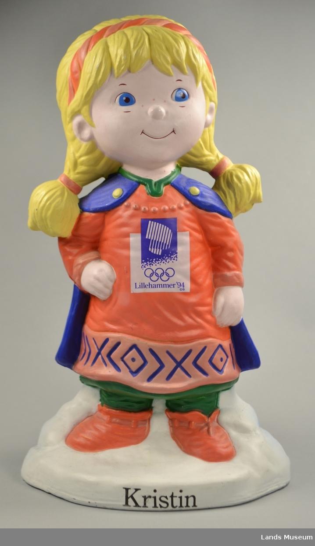 Bøssa er forma som Kristin som var maskot, OL på Lillehammer 1994.