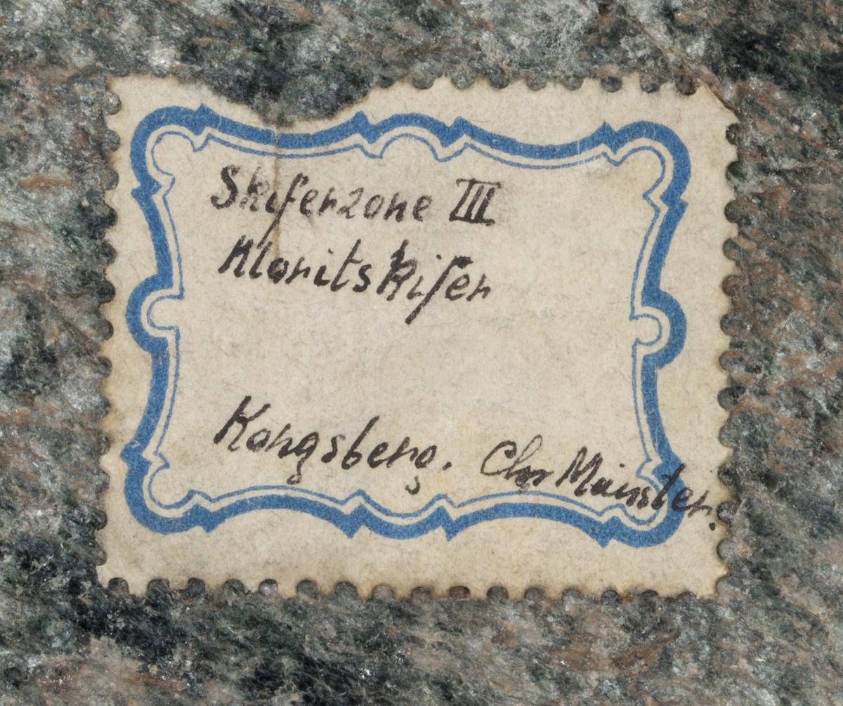 Etikett på prøve: Skiferzone III Kloritskifer Kongsberg. Chr. Münster.