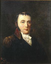 Portrett av eidsvollsmann og byfogd Andreas Michael Heiberg.  Yngre mann med mørkt hår, tynt på toppen, mørkt kinnskjegg. Mørk rød kledning med oppstående krage, hvit skjorte.