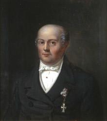 Portrett av Ole C Mørch. Mørk drakt, hvit skjorte, vest og halsbind. Orden festet på brystet. (Foto/Photo)