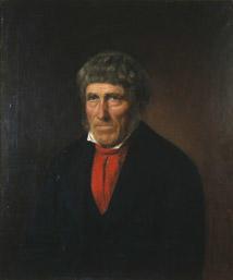 Portrett av Thorsen. Mørk kjol (jakke) og vest, rødt halstørkle, hvit skjorte.