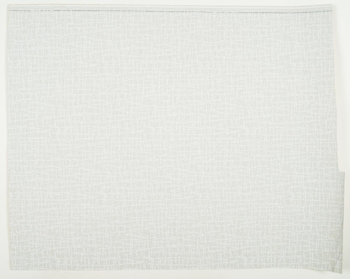 Byggtapet. Ljusgrå botten med effektmönster i vitt. IB