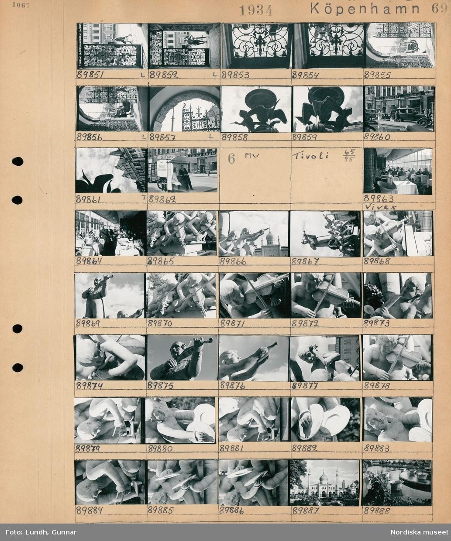 """Motiv: Köpenhamn, Rådhusplatsen, Polyfotos 27/31, baR 32/38, Kgl. Porslinsfabr. 47/57, portal; Gatuvy med grind och forgängare, detalj av grind, fontäng, gatuvy med fotgängare  och bilar, ett försäljningsstånd med skylt """"Smörrebröd"""".  Motiv: Köpenhamn, Tivoli: Interiör av restaurang Vivex, en skulptur, exteriör av en byggnad, en fontän."""