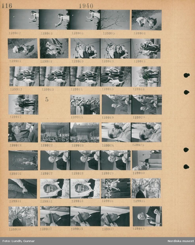 """Motiv: Kamr. Helge Waerlands barn Palten o Kerstin; En flicka kastar boll, porträtt av en flicka och en pojke, en man men en flicka och en pojke.  Motiv: (ingen anteckning) ; En kör med studentmössor sjunger på en scen, en man håller ett tal, vy över en folksamling framför en scen, en fana """"Ungdoms Logen Solstrålen I.O.G.T. """"."""