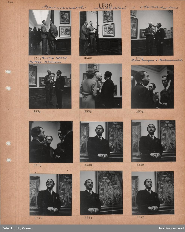 Motiv: Grünewald utställer i Stockholm, två män, kronprins Gustaf Adolf och Gottfr. Johansson, samtalar i utställningssal med tavlor på väggarna, två män, prins Eugen och Grünewald, samtalar framför vägg med tavlor, utställningsbesökare, porträttbilder av Isaac Grünewald vid en av sina målningar.