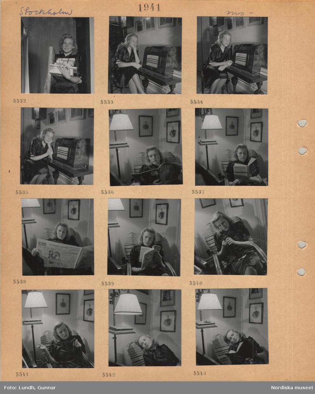 Motiv: Stockholm, modell i klänning som poserar, med inslagna paket i famnen, sitter vid en radio och lyssnar, sitter i en fåtölj och läser, stoppar strumpor, golvlampa.