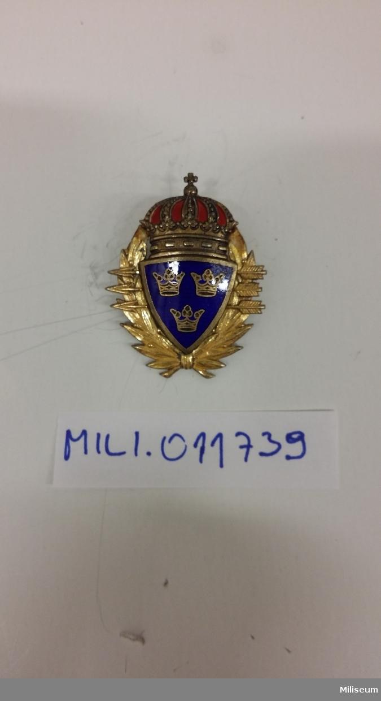Automatvapenskyttemärke i förgylld mässing och förgyllt silver med emalj.