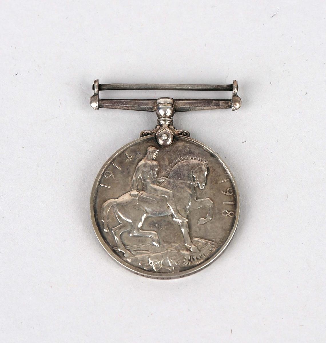Sølvmedalje med portrett av Georg IVS V på forside og en naken mann som rir på en hest på baksiden.