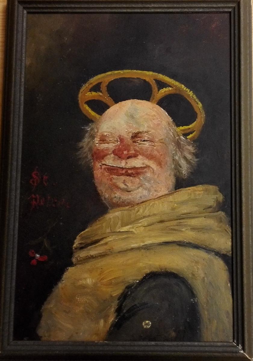 """Måleriet er ei humoristk framstilling av  St. Peter, og er måla med olje på tre og har enkel mørk treramme. Det har ei litt utydeleg påskrift, truleg """"St, Petrus""""."""