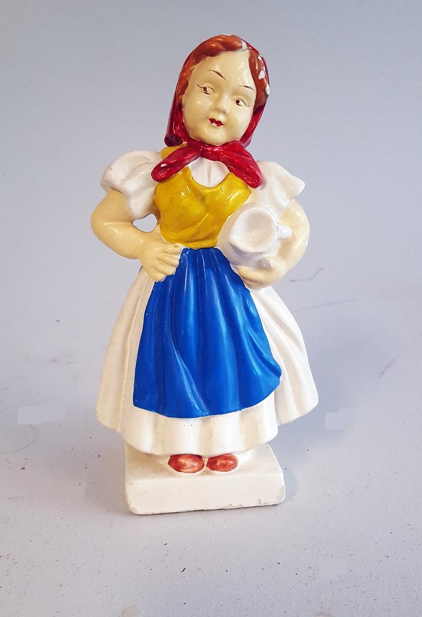Figur i form av jente.