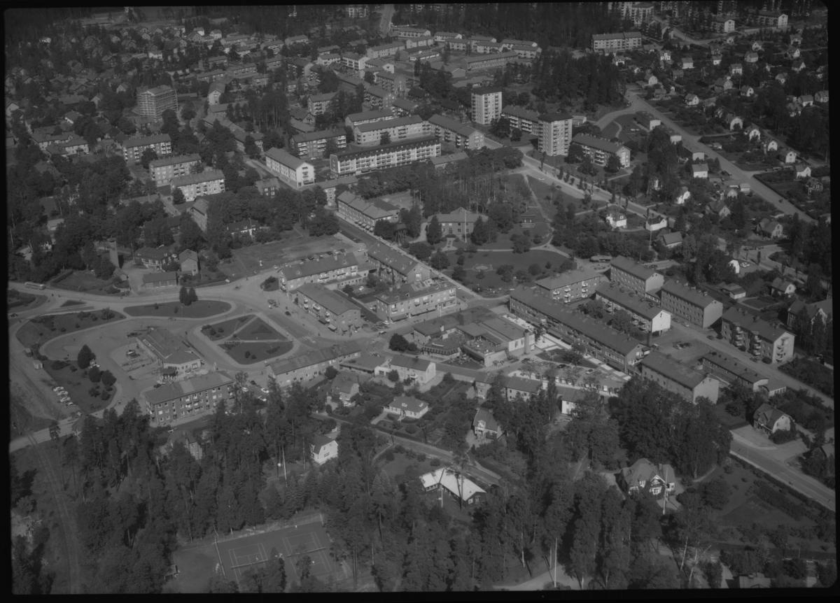 Flygfoto över Fagersta centrum, Fagersta. Tagen 1962 av AB Flygtrafik Dals Långed.