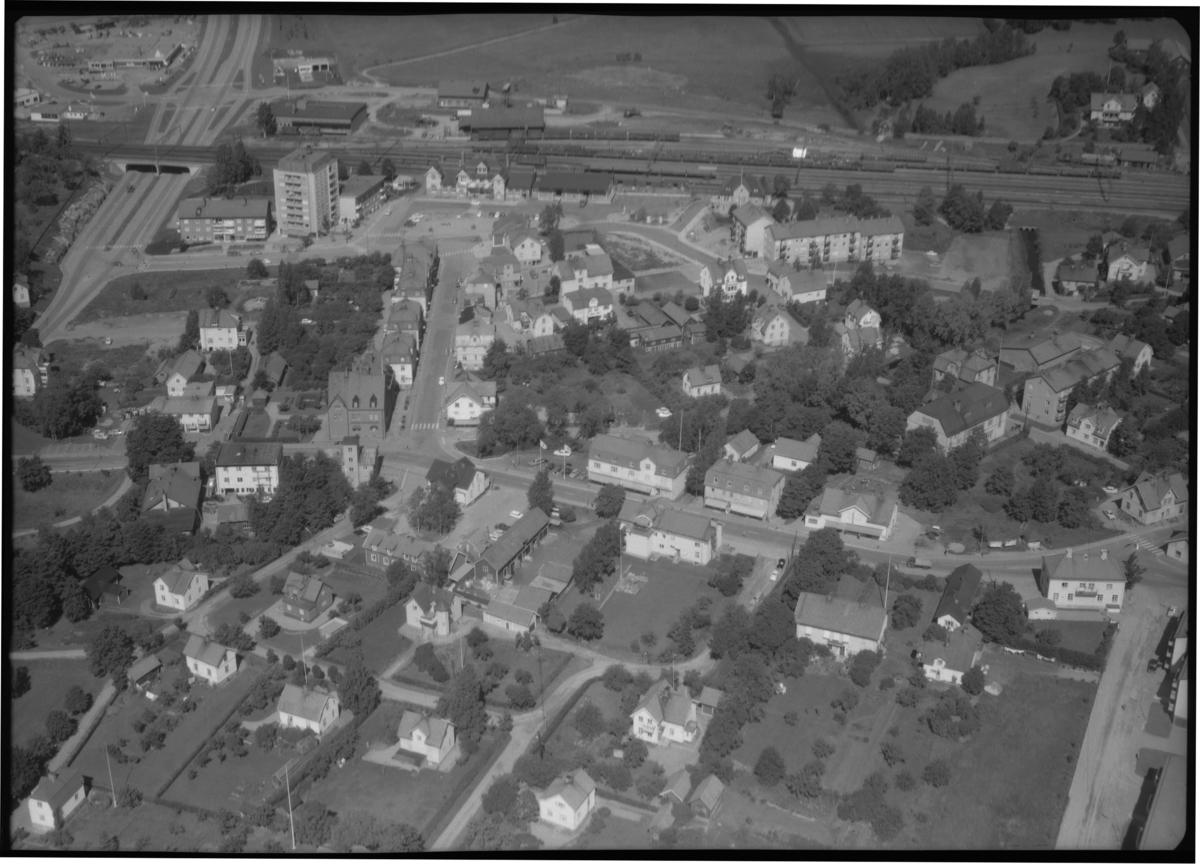 Flygbild över stadsdel Västanfors, Fagersta. Tagen 1965 av AB Flygtrafik Dals Långed.