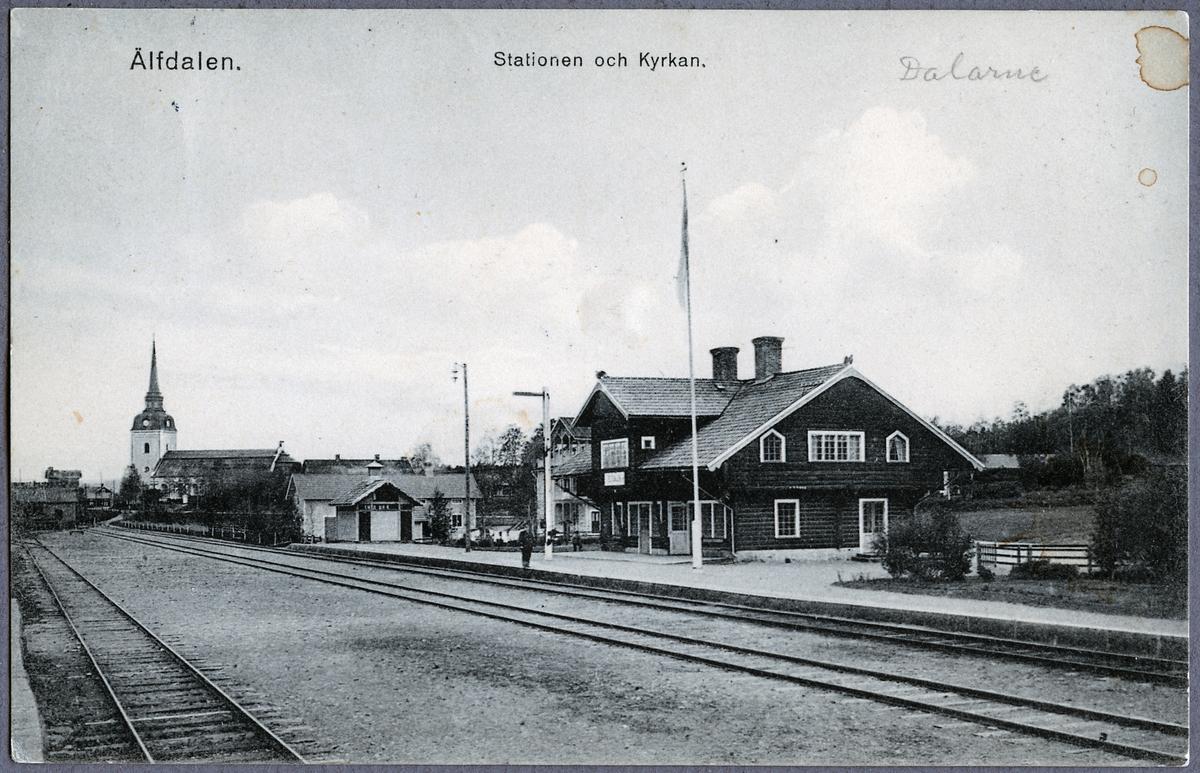 Älvdalens station och kyrka i bakgrunden.