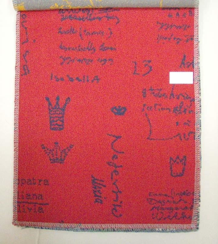 Åtta stycken tygprover i häfte framtaget som förslag till stolsbeklädnad för de så kallade Reginatåg (motorvagnståg) som Bombardier tillverkade i början av 2000-talet, i färgerna röd, gul, klarröd, grågrön, ljusblå, ljusgrön, mörkblå och ljusbeige, med mönster som föreställer namn på drottningar samt siffror och kronor.  Bilderna  är __A till __H.
