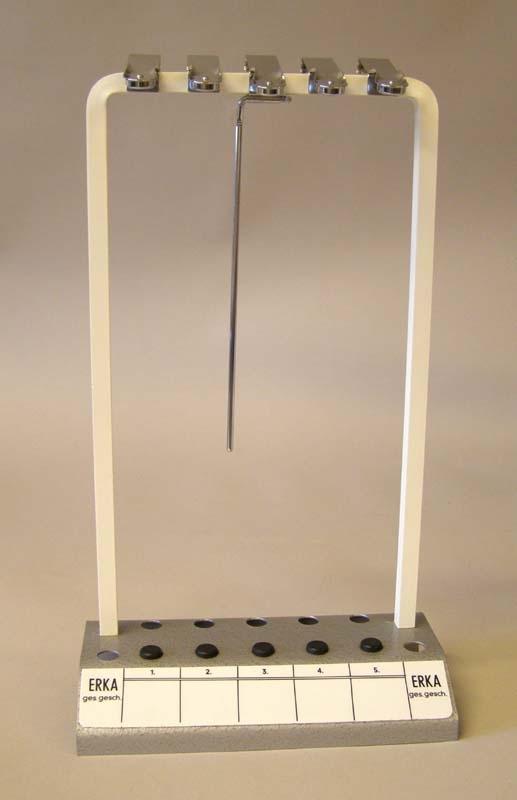 Hållare för glasrör vid provtagning av sänkan. I bottenplattan, hål för glasrör och klämmor upptill. Plats för fem rör, och en graderad skala från ett till fem på bottenplattan.