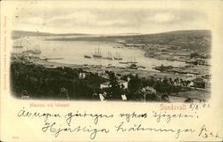 Vykort med motiv över hamnen och inloppet i Sundsvall.