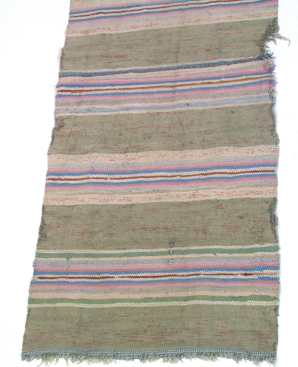 Brede brune striper, smalere blå og hvite.