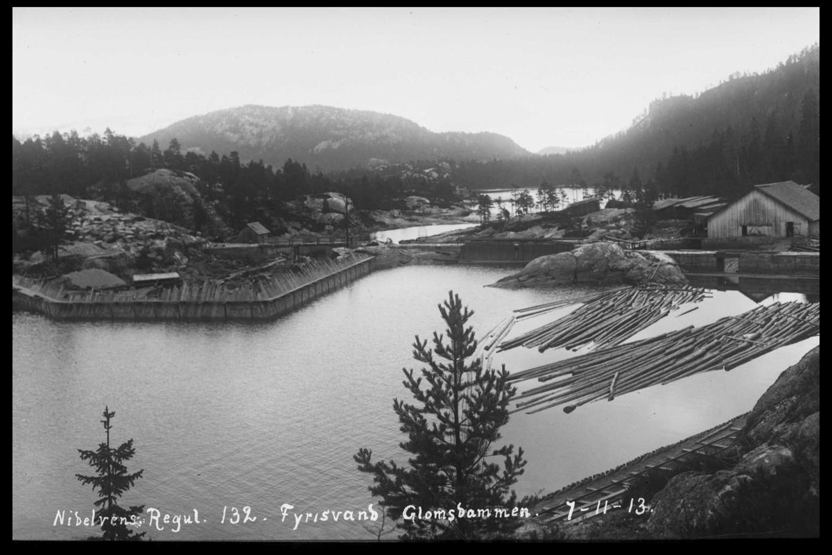 Arendal Fossekompani i begynnelsen av 1900-tallet CD merket 0565, Bilde: 32 Sted: Fyrisvann Beskrivelse: Regulering Glomsdammen. Vi ser Glomfoss bruk til høyre.
