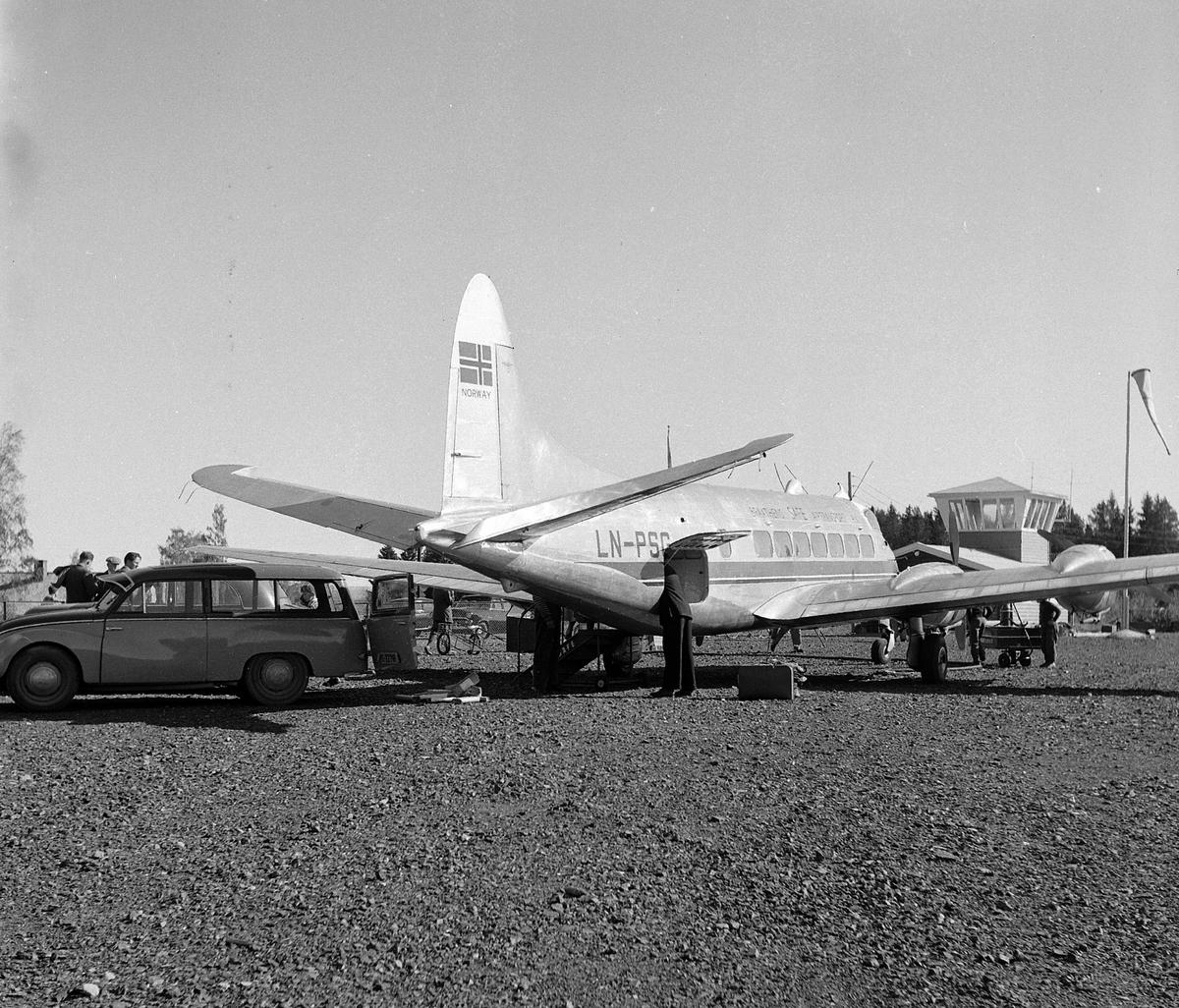 "Hamar flyplass, ""de Havilland  DH 114 Heron""  verdens minste firemotors propellfly fra Braathens Safe Airtransport a/s, LN-PSG, ""Ola"""