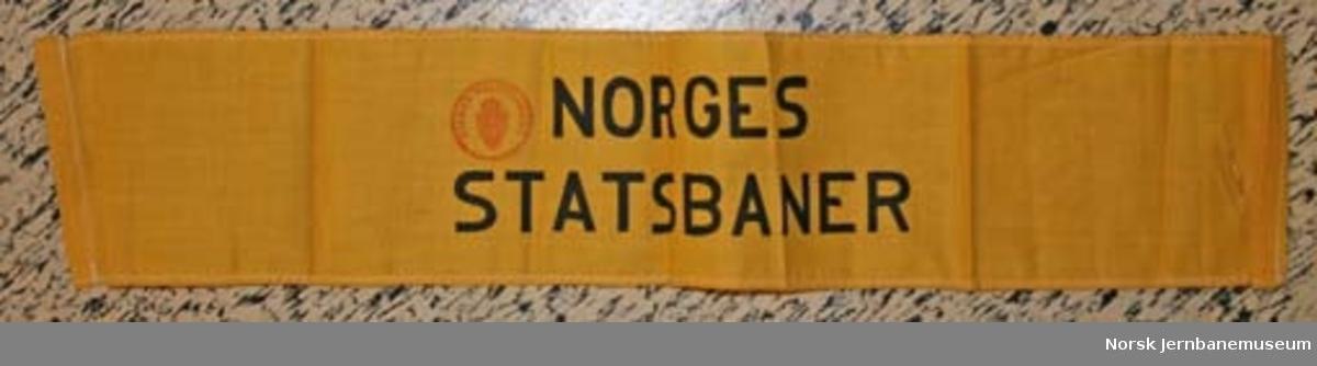 """Armbind med teksten """"NORGES STATSBANER"""""""