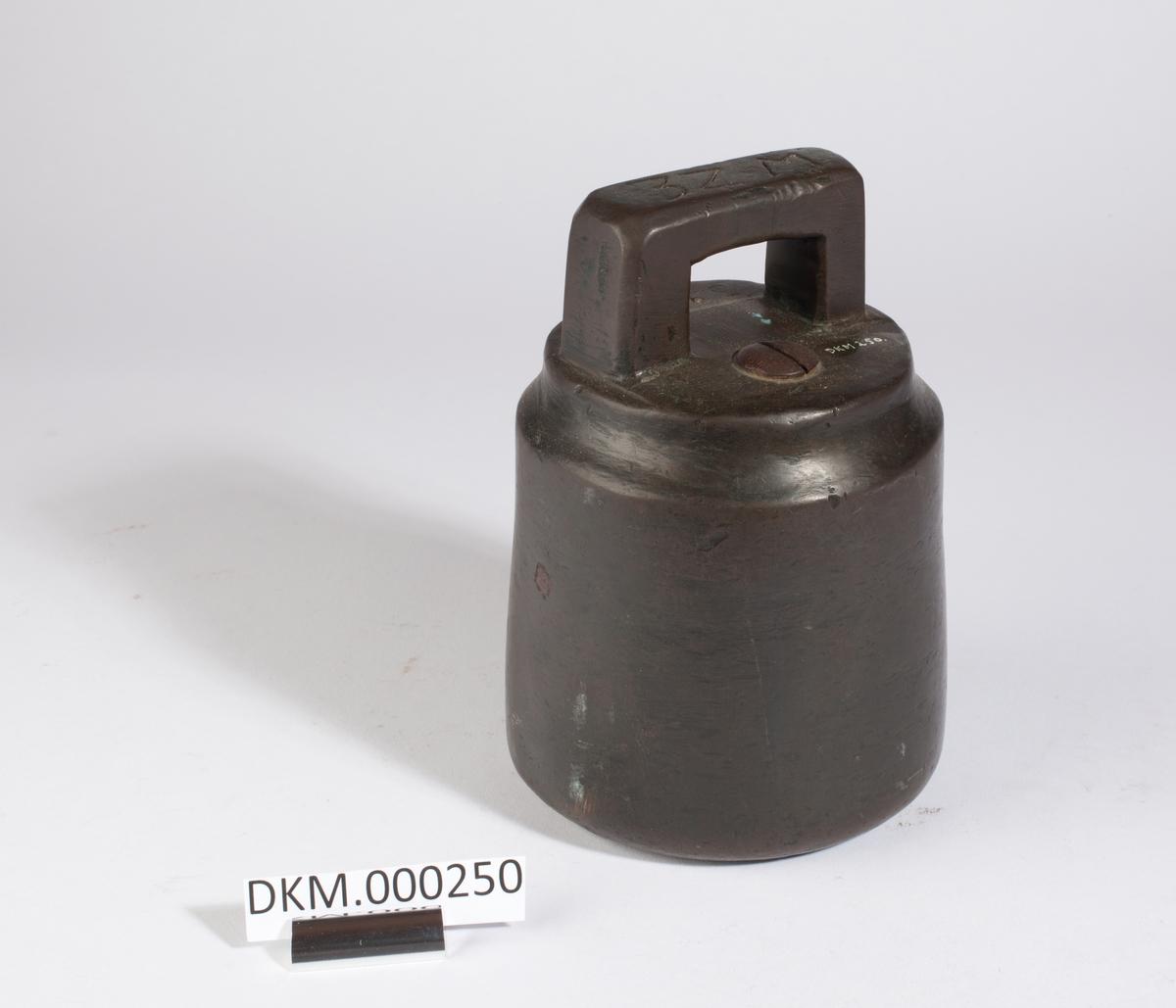 Sylinderform med håndtak.