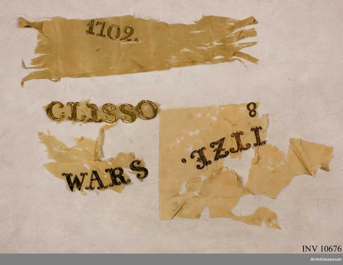 Grupp B.  Duk av fyrskaftat vitt fansiden. Segernamn: Clisso(w) 1702.