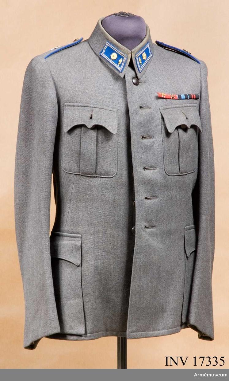 Grupp C I. Ur uniform bestående av vapenrock, byxor och livrem. Ingår i uniform m/1939 för ingenjörmajor vid Försvarsministeriet i Finland.
