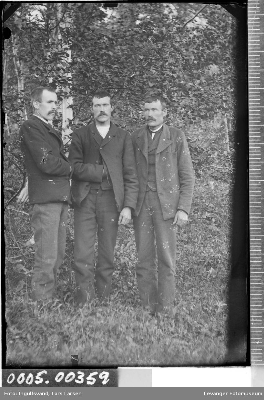 Gruppebilde av tre menn.