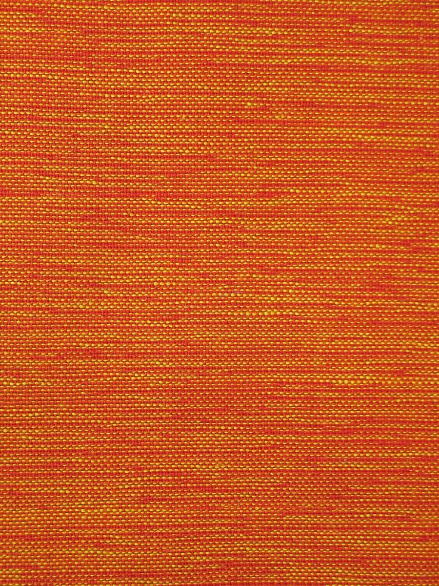 Tøystykket har oransje bomullsrenning og dobbelt innslag med rød og gul ulltråd. Vevbredden er 71 cm, og to lengder er sydd sammen.