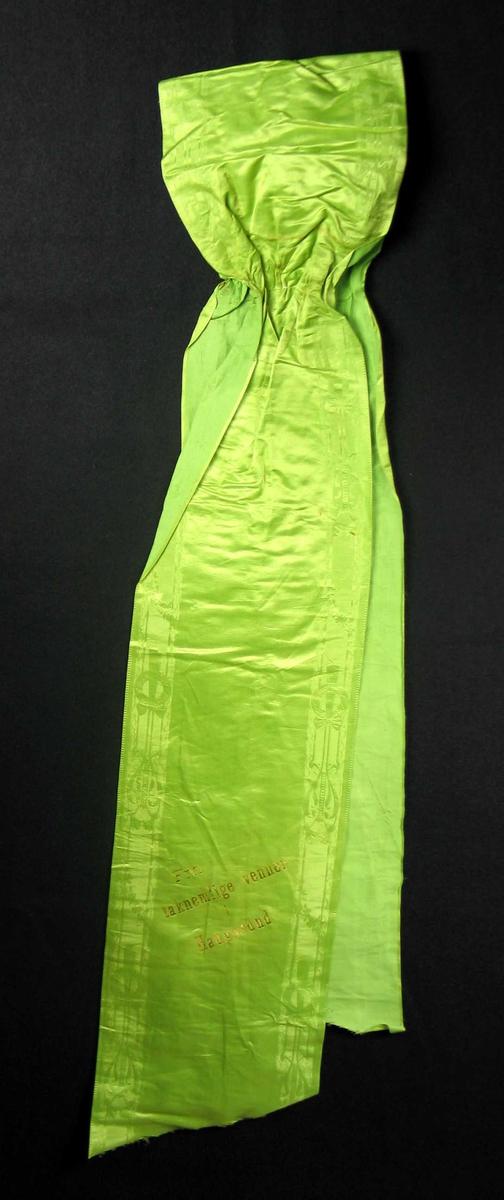 Begravelsessløyfe i lys grønn silke med innvevd mønsterbord.