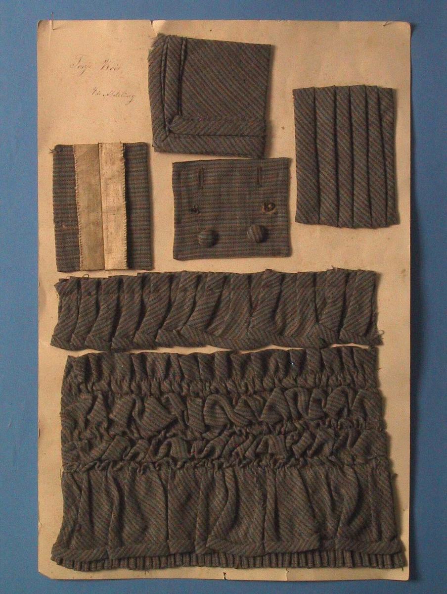 Tekstilprøve montert på kartong