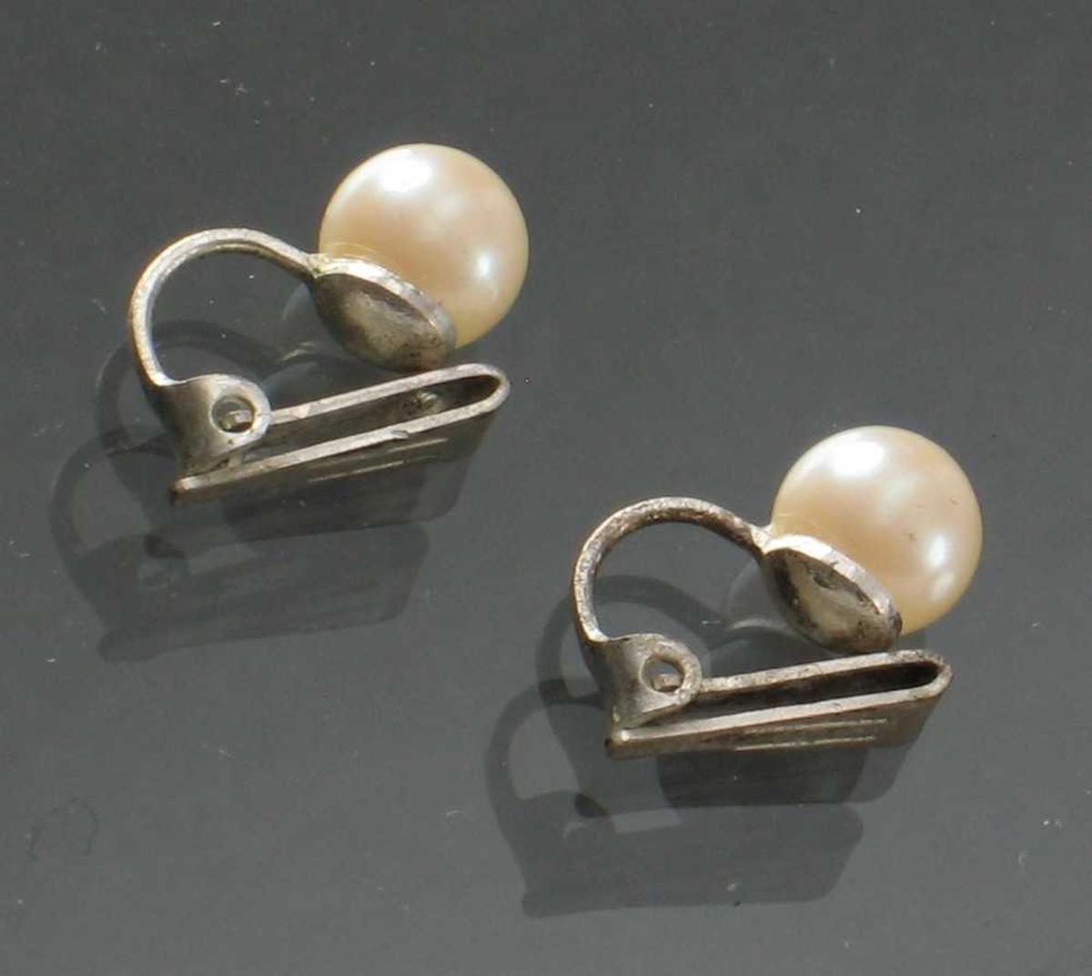 Perleøredobber med klyper.